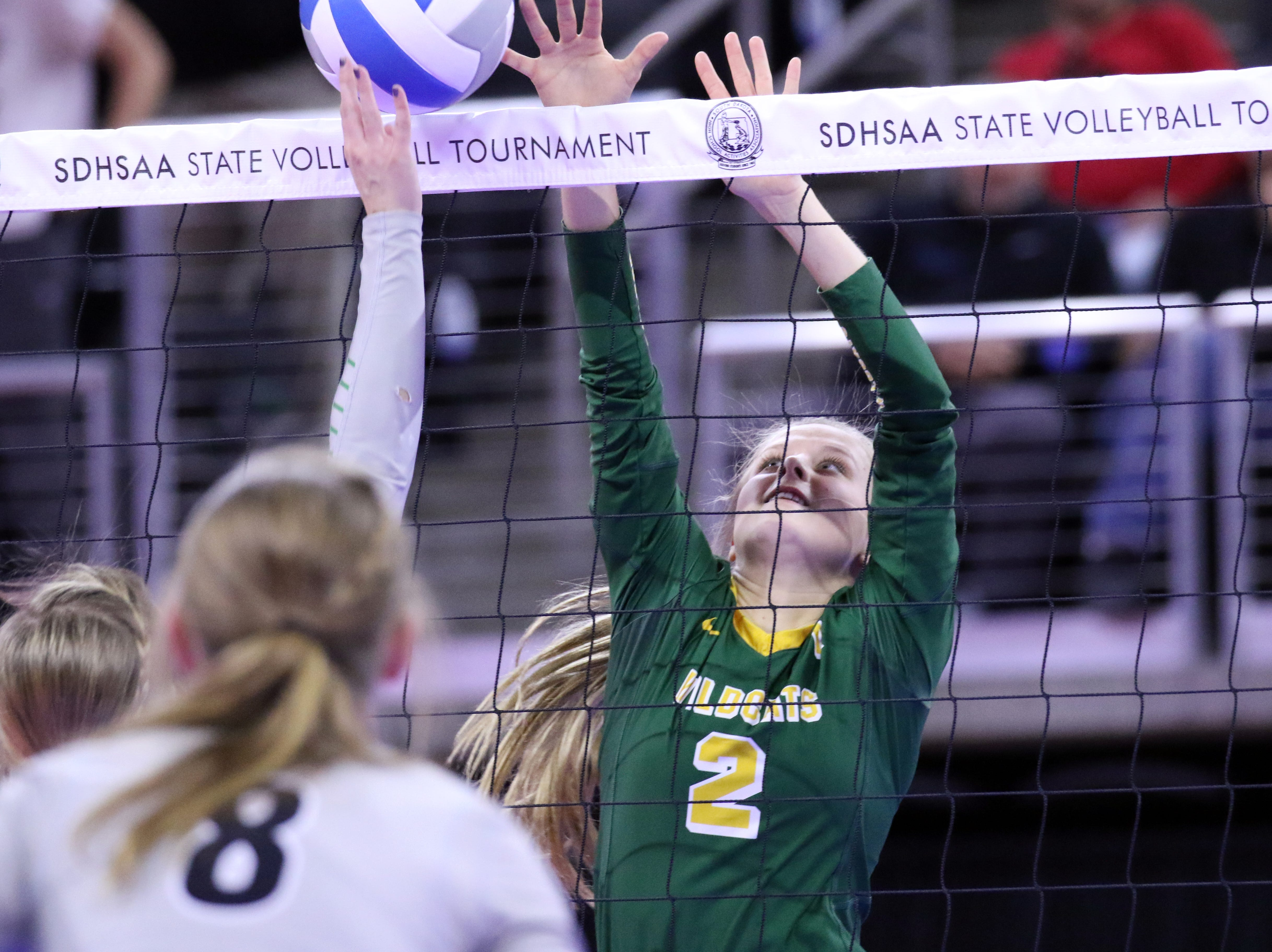 Madalyn Groft of Northwestern goes up to block a spike as Kennedy Lieferman (8) of Kimball-White Lake watches on Thursday in Sioux Falls.