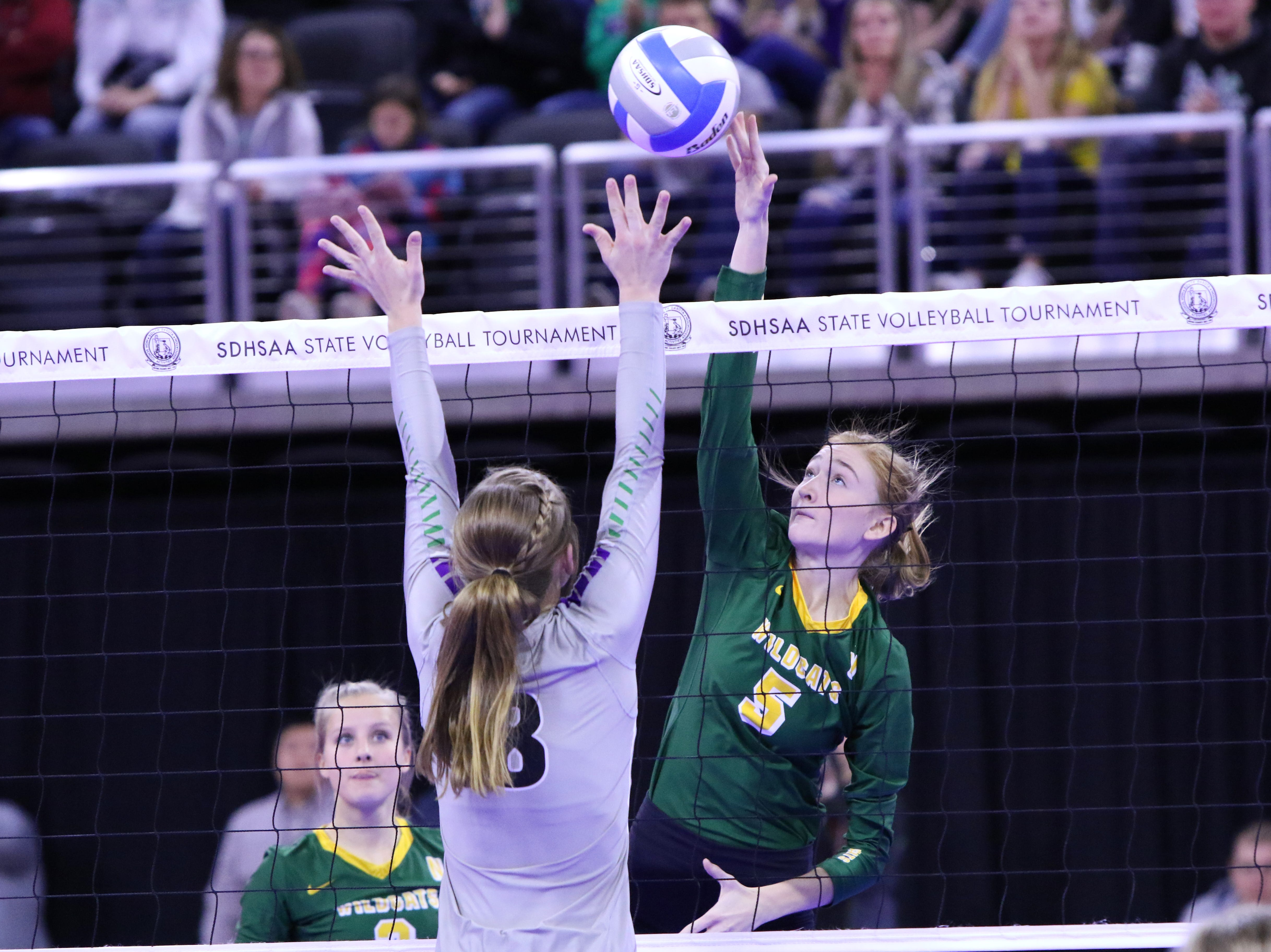 Riley Grandpre of Northwestern spikes the ball past the defense by Kennedy Leiferman of Kimball-White Lake during Thursday's state tournament in Sioux Falls.