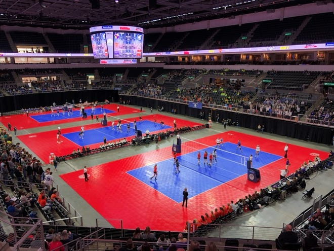 Three courts were in action for the first round of the state volleyball tournament.