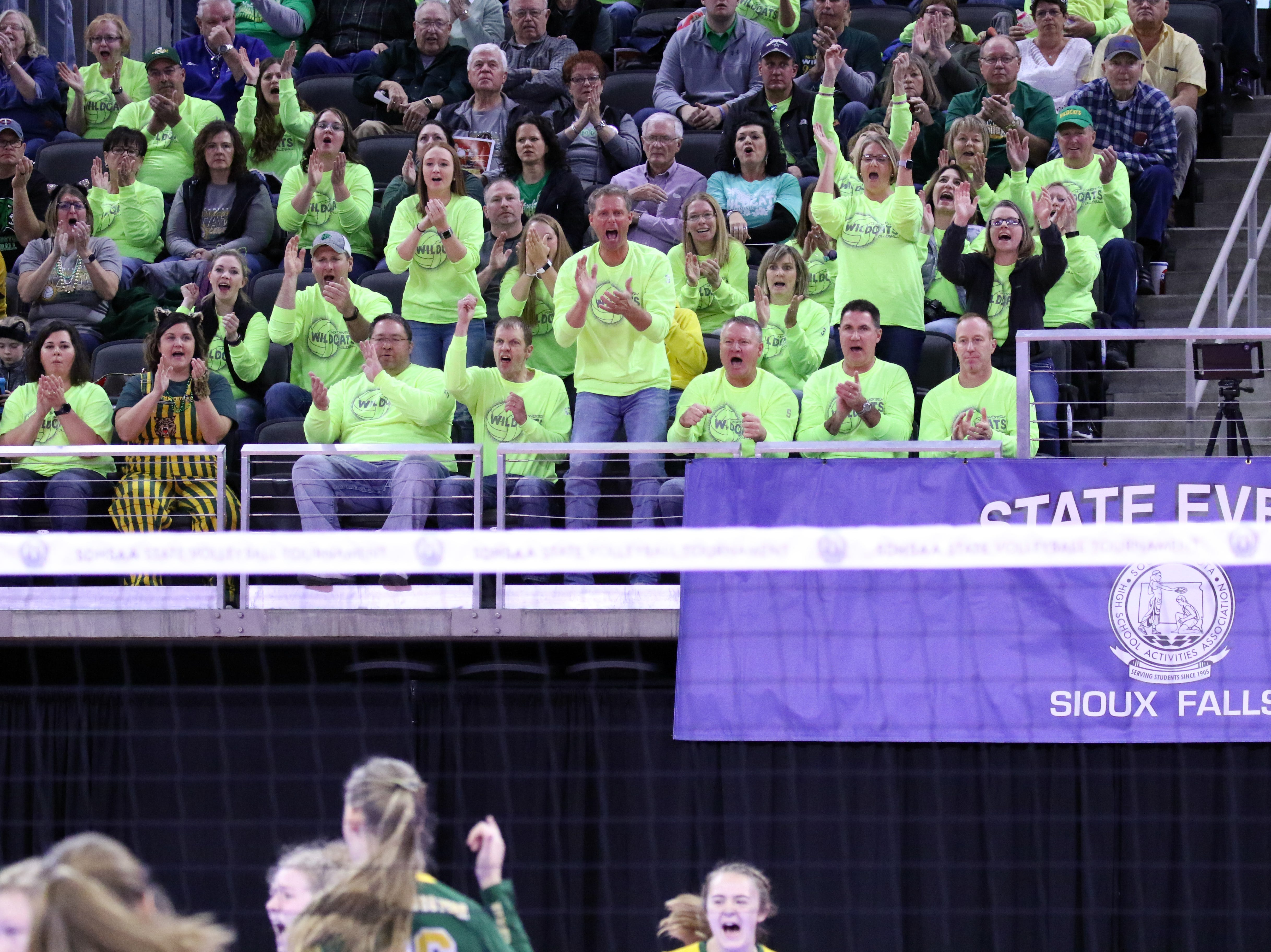 Fans from Northwestern cheer after a point during Thursday afternoon's match against Kimball-White Lake in Sioux Falls.