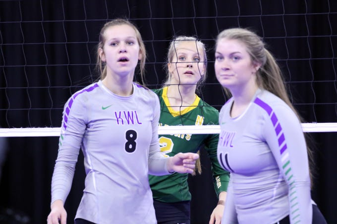 Madalyn Groft of Northwestern looks between Hannah Schentzel (8) and Talley Sparling of Kimball-White Lake for the next serve during Thursday's match in Sioux Falls.