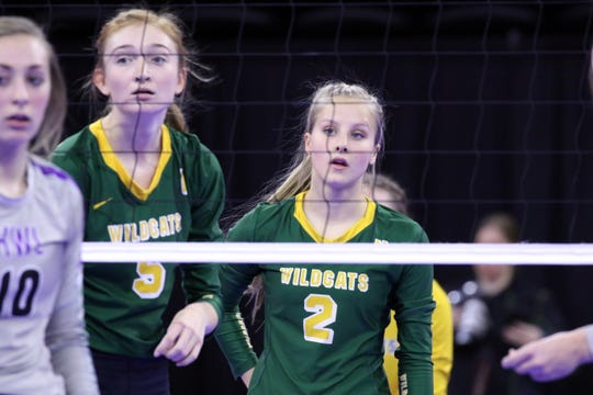 Madalyn Groft (2) and Riley Grandpe await the next serve during Thursday afternoon's match against Kimball-White Lake in Sioux Falls.