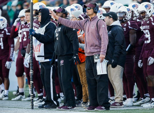 Marcus Yokeley , center, signals from the sideline during Missouri State University's game against North Dakota State at Plaster Stadium on Saturday, Nov. 10, 2018.