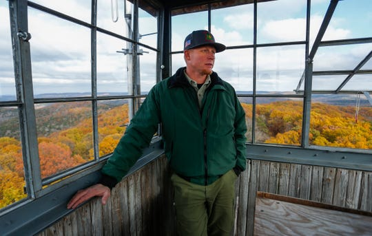 Reggie Bray, a Forest Service fire management officer, atop a fire watch tower in the Hercules Glades Wilderness Area on Friday, Nov. 9, 2018.