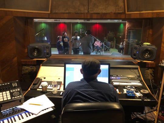"Mozark Studios owner-producer Shawn Matthews works with a team of choir students from Reed Academy on Nov. 7, 2018 to record a track for ""Holiday Crossroads,"" a music album put out by the city of Springfield to help fund the Festival of Lights"