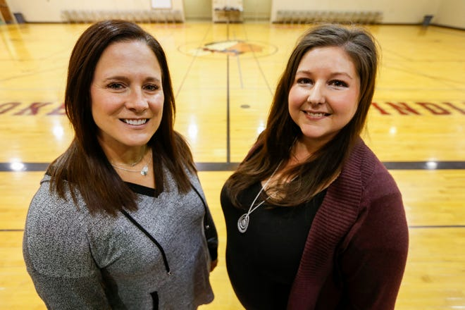 Lori Endicott-Vandersnick, left, and Amber Huddleston are volleyball coaches at Cherokee Middle School.