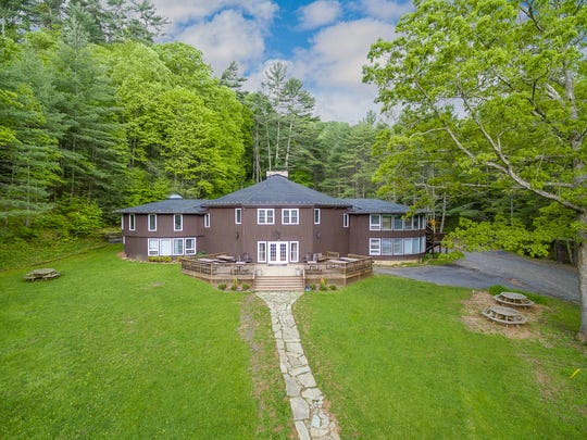This 375 acre property and lodge is up for sale in Headwaters at 6983 Cowpasture Road. The year-round lodge was designed by T.J. Collins and Sons and can be utilized as a bed and breakfast, counseling center, retreat and more. The property features nine separate buildings with various fire pits, a ropes course, climbing wall and a soccer/volleyball field.
