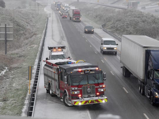 Sleet continues to fall as a Riverheads fire engine remains on the scene of a wreck on Interstate 81 at the Barterbrook Road overpass on Thursday afternoon, Nov. 15, 2018.