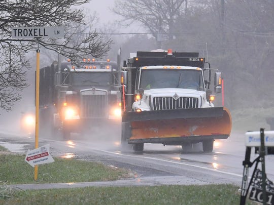 Sleet mixed with rain falls as a snowplow with the Virginia Department of Transportation travels with plow raised on U.S. 250 on Thursday, Nov. 15, 2018.
