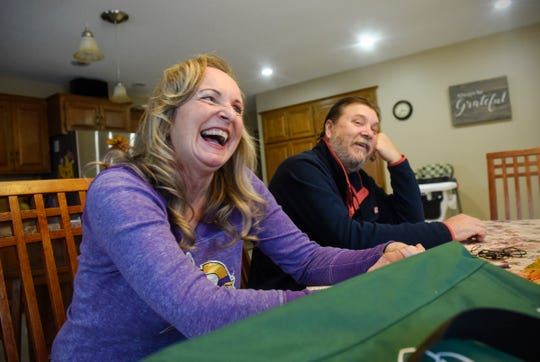 Mary Ziegler and Bill Henrichs smile while talking about their recent medical experiences during an interview Friday, Nov. 9, in St. Cloud.