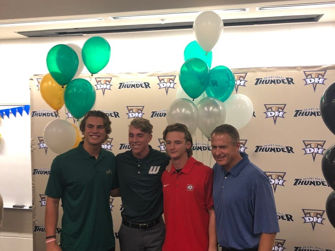 Desert Hills baseball players (from left to right) Drew Thorpe, Dallen Turner and Landon Levine are joined by head coach Chris Allred at their national letter of intent signing day ceremony on Nov. 14.