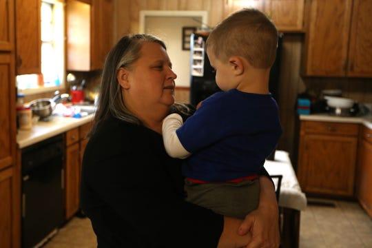 Audrey Williams holds her grandson, Braxton Prescott, 3, in her home in Grand Ridge, Fla. on Thursday, Nov. 15, 2018.