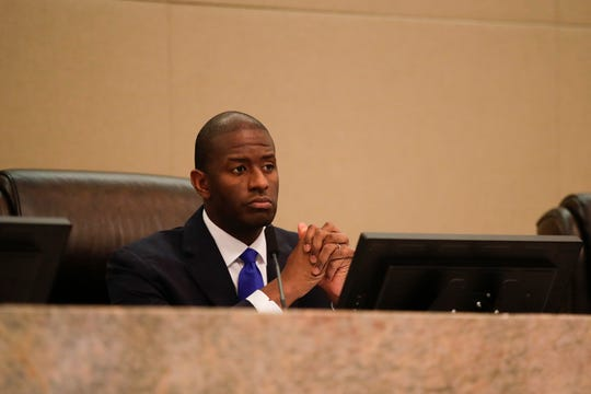 Mayor Andrew Gillum listens to speakers during his last city commission meeting Wednesday, Nov. 14, 2018.