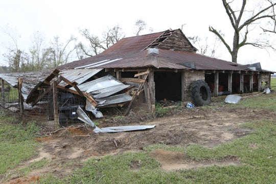 A barn on the Williams' property in Grand Ridge, Fla. was damaged during Hurricane Michael, Thursday, NOv. 15, 2018.