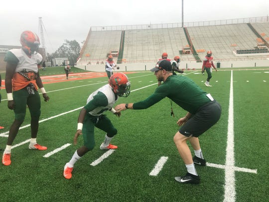FAMU wide receiver Xavier Smith works with assistant coach Joseph Henry in prep for the Florida Classic.