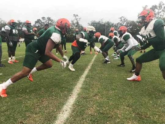 FAMU defensive line rushes in during practice for the Florida Classic.