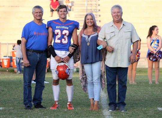 Taylor County senior Max Kallschmidt with his family during senior night.