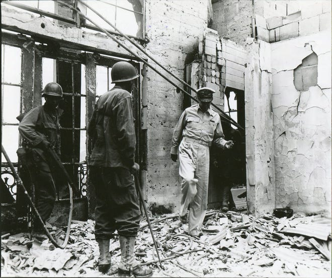 Gen.Douglas MacArthur returns to the ruins of his burned out home during the Battle of Manila on Feb. 23, 1945. Three years earlier, he left the Philippines as Japanese forces advanced.