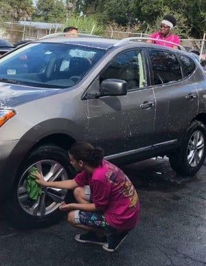 Burmese Martial Arts Academy Saya (Instructor) Gustavo Santa sponsored a car wash fundraiser at Pep Boys Auto Service & Tire on US 1, Fort Pierce.