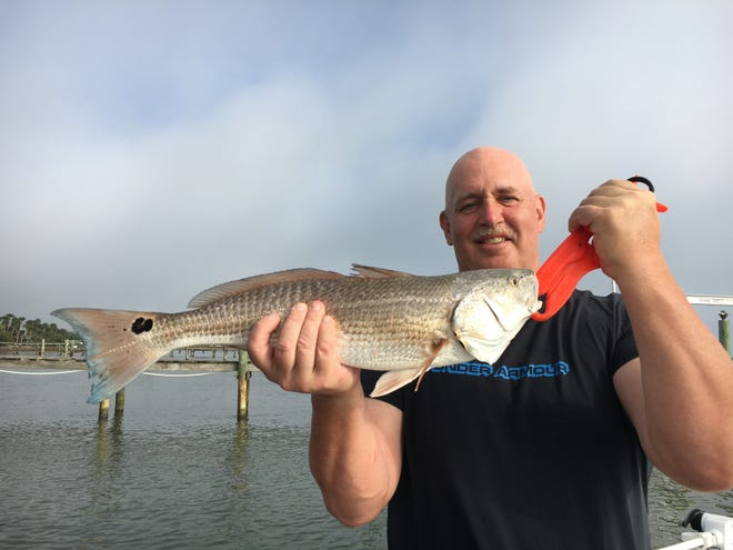 Bill topped off the day with this nice slot redfish that was released to fight again.