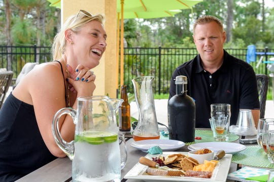 Ocean Republic Brewing founders Chris and Amanda Cischke show some off some their craft beer creations and discuss their plans for the brewery Thursday, Nov. 15, 2018, in their home on the 6500 block of Southwest Key Deer Lane in Palm City. Ocean Republic Brewing is expected to open early 2019 in Stuart, which would be the 10th brewery on the Treasure Coast and the only one in Martin County.
