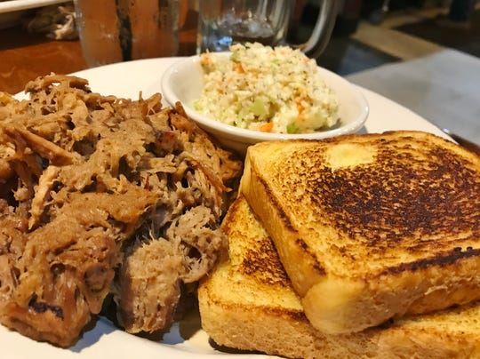 Cowboys BBQ & Steak Co.'s  pulled pork sandwich has pork butt rubbed with mustard and barecue seasoning then smoked for 12 hours.