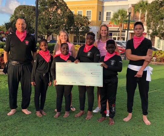 Burmese Martial Arts Academy donated $500 to Random Acts of Pink at Tradition Square.