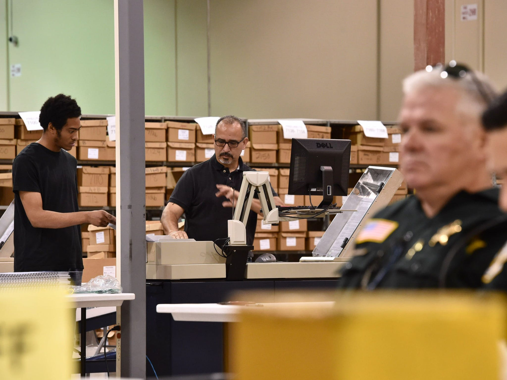 Officials with the Palm Beach County Supervisor of Elections Office work to continue counting ballots Thursday, Nov. 15, 2018, in Riviera Beach.
