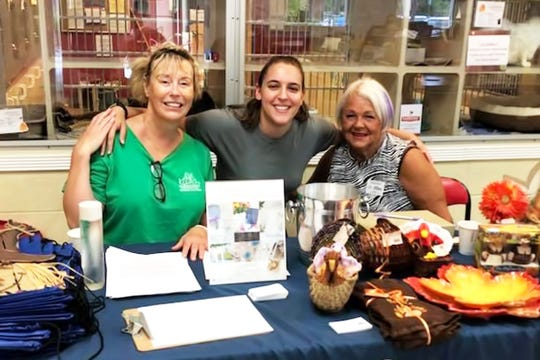 Cat care volunteer Cat Matheson and thrift store volunteer Ellen Spader with volunteer-for-a-day Amber Perlmutter (center) who hopes to become a full-fledged volunteer soon