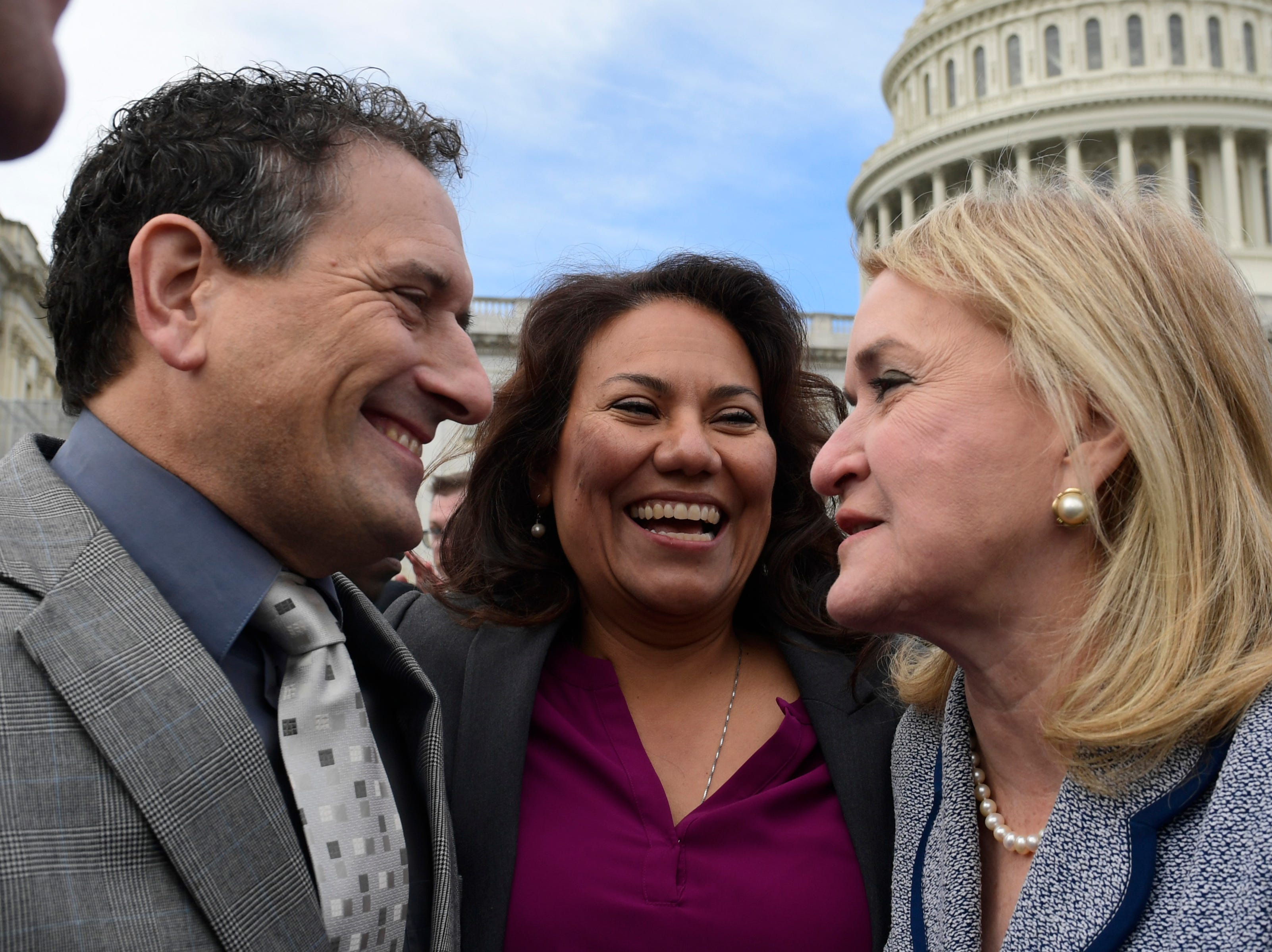 U.S. Rep.-elect Andy Levin, D-Mich., left, U.S. Rep.-elect Veronica Escobar, D-El Paso, center, and U.S. Rep.-elect Sylvia Garcia, D-Texas, talk after a photo opportunity for the freshman class Wednesday, Nov. 14, 2018, on Capitol Hill in Washington.