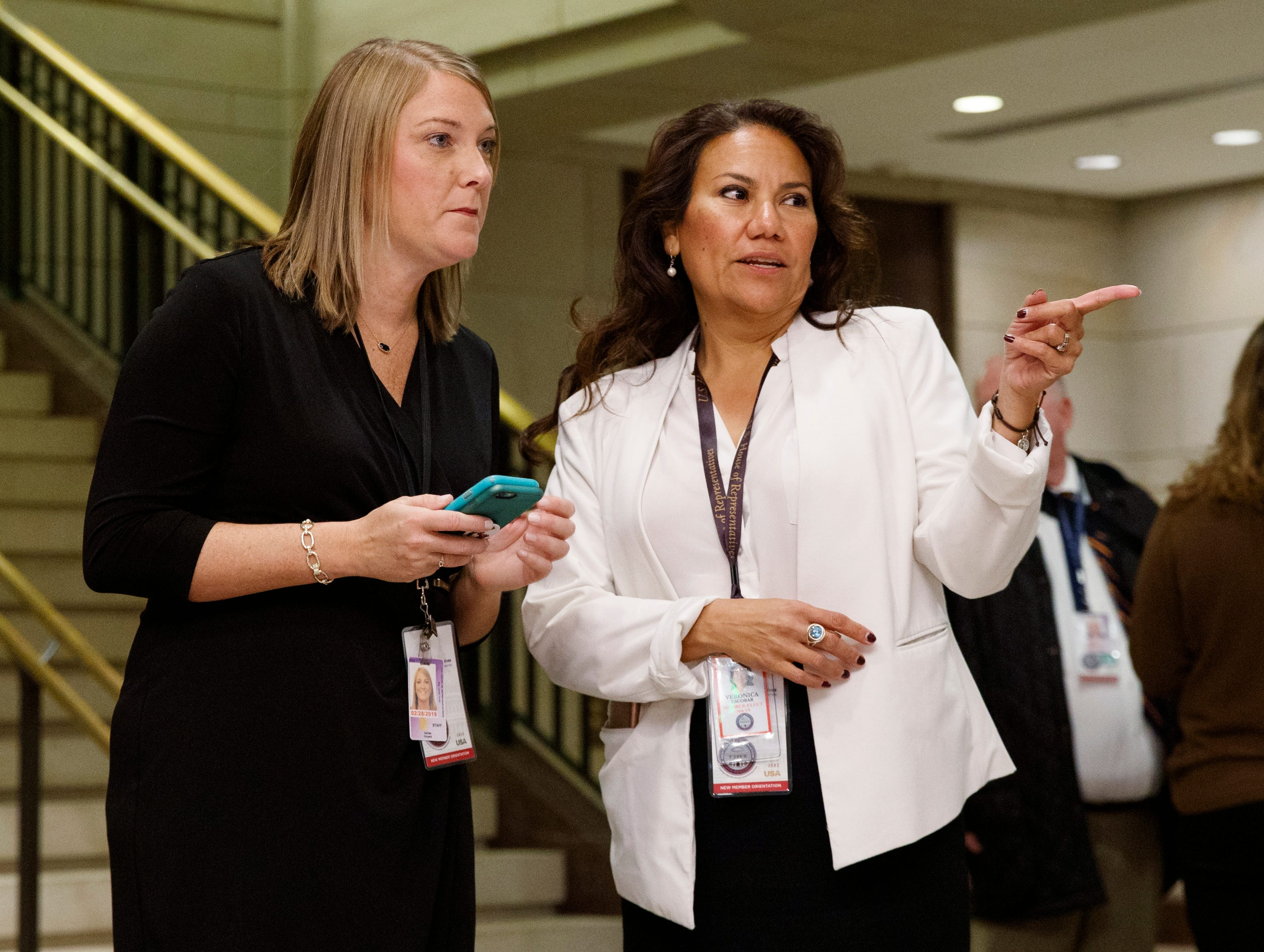 U.S. Rep.-elect Veronica Escobar, D-El Paso, asks questions as she arrives for member-elect briefings Thursday, Nov. 15, 2018, on Capitol Hill in Washington, D.C.