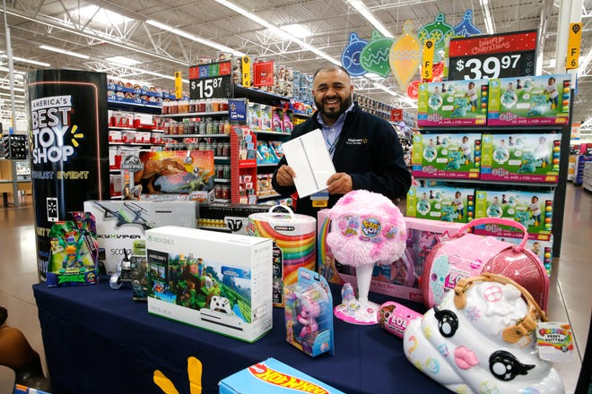 Carlos Aguilar, a store manager for Walmart, holds up an iPad which is one of several items that will be on sale during Black Friday. The east side store will have several items in limited quantities that go on sale Thursday afternoon at 6 p.m. but are available online beginning at midnight.