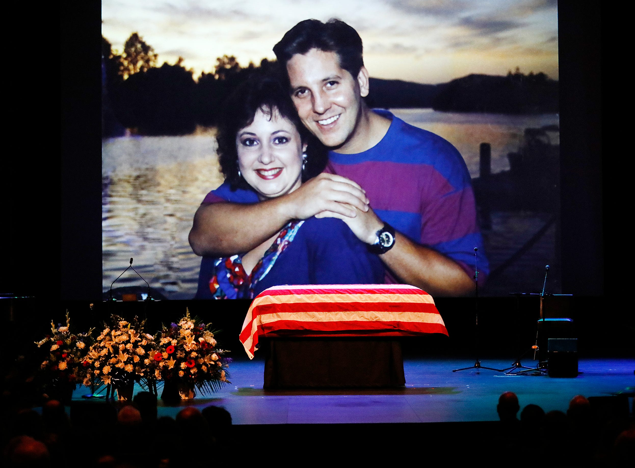 An old family photo of Ventura County Sheriff's Office Sgt. Ron Helus with his wife Karen is shown during a video montage at Helus' memorial service at Calvary Community Church in Westlake Village on Thursday.
