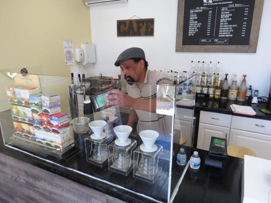 Chris Curtis rearranges items at Rivalry Roasters, the Simi Valley-based coffee business he launched late last year with Borderline shooting victim Sean Adler. The business' wholesale operations continue. But following Adler's death, Curtis isn't sure when, or if, its retail space will reopen to the public.