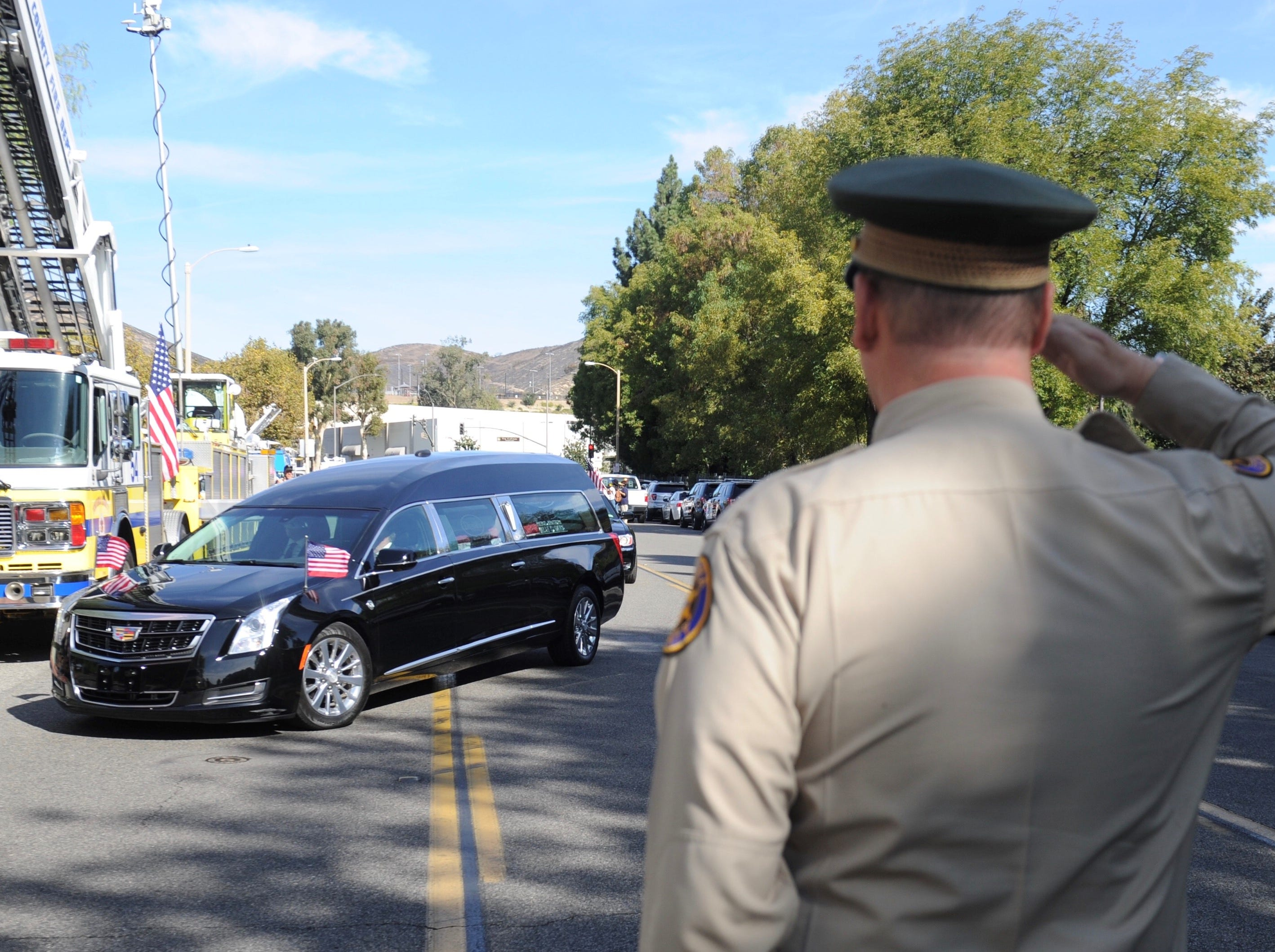 The hearse bearing the body of Ventura County Sheriff's Office Sgt. Ron Helus arrives Thursday at Calvary Community Church in Westlake Village.