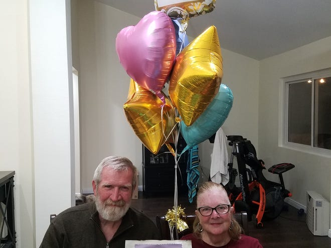 Dona and Patrick Futvoye lost their Newbury Park home in the Hill Fire a day before their 50th wedding anniversary. They celebrated at their daughter's house.