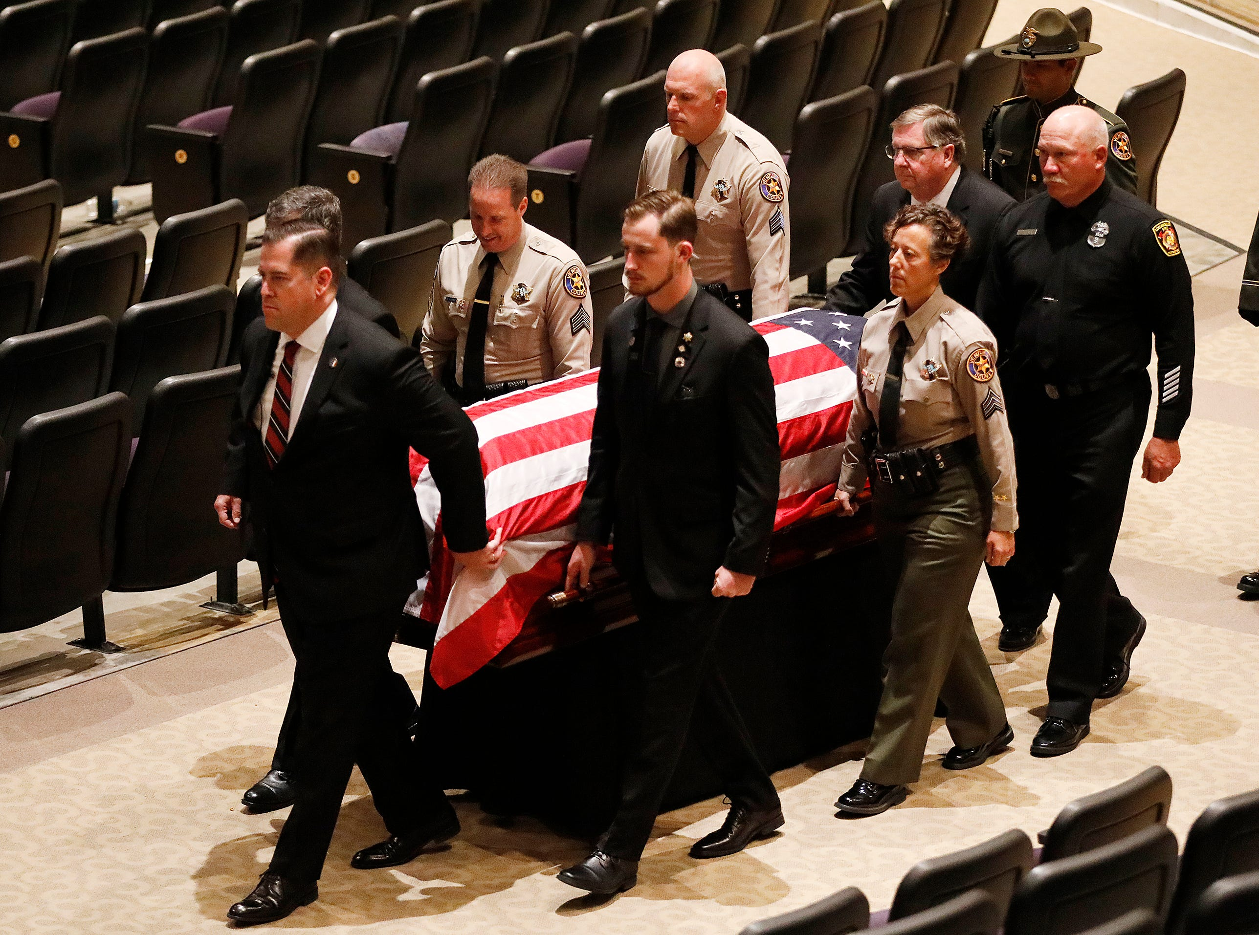 The casket with the body of Ventura County Sheriff's Office Sgt. Ron Helus is carried out after his memorial service at Calvary Community Church in Westlake Village on Thursday.