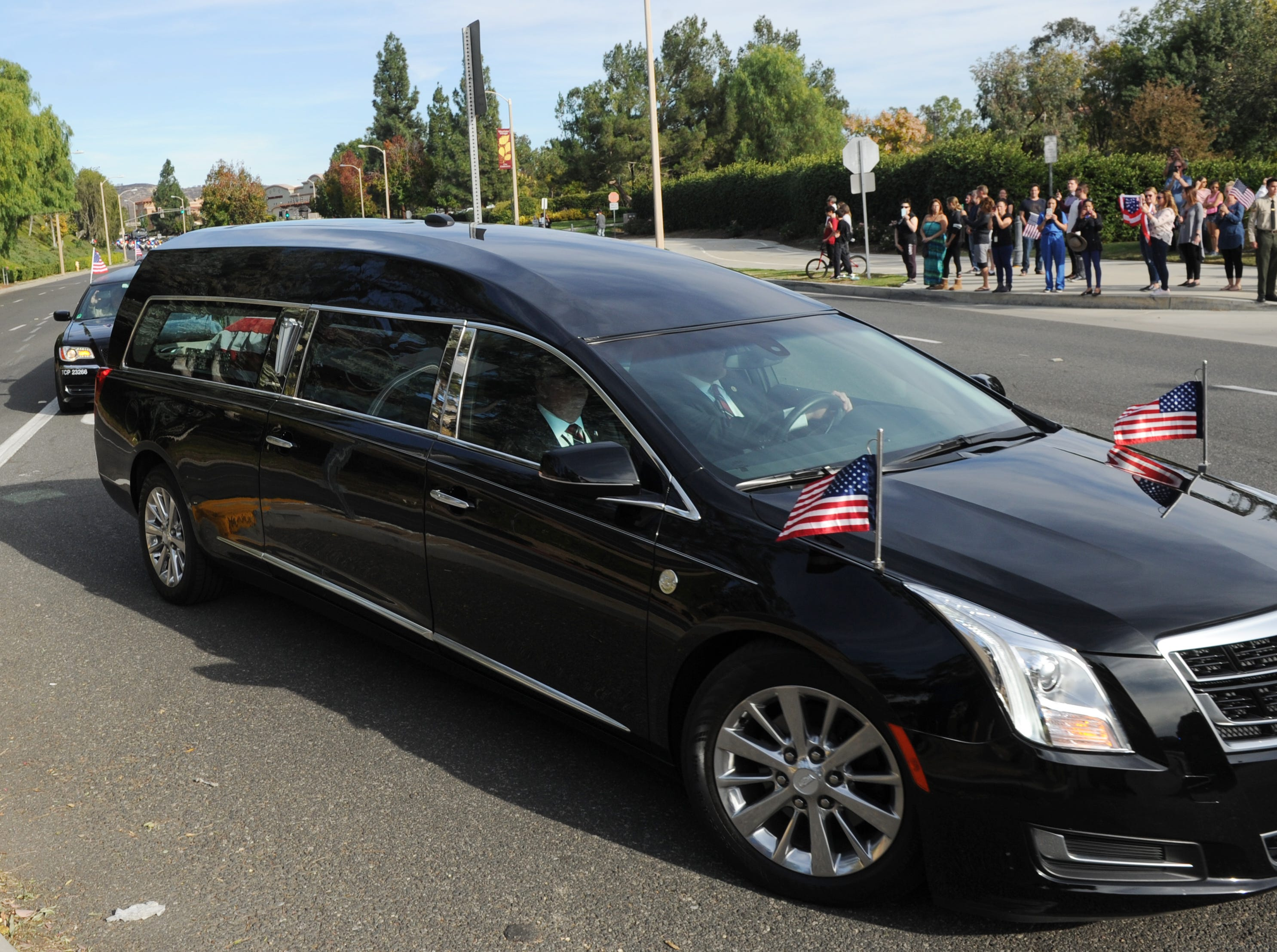 The funeral procession for Ventura County Sheriff's Office Sgt. Ron Helus arrives at Pierce Brothers Valley Oaks Griffin Memorial Park, Mortuary & Crematory.
