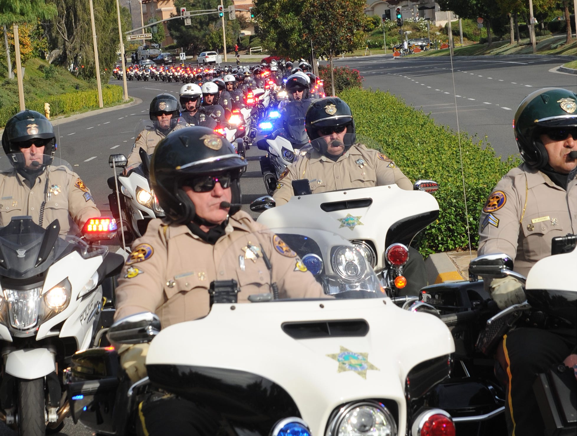 The funeral procession for Ventura County Sheriff's Office Sgt. Ron Helus arrives at Pierce Brothers Valley Oaks  Memorial Park on Thursday in Westlake Village.