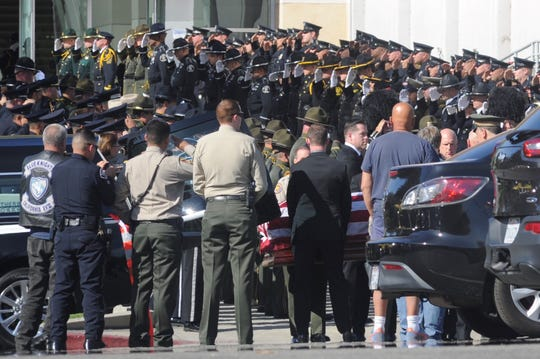 Officers salute as the casket of sheriff's Sgt. Ron Helus arrives for his memorial service after the Borderline shooting. Senate Bill 542 comes on the heels of two consecutive record-breaking fire seasons and a series of mass shootings, including the Borderline shooting in Thousand Oaks.