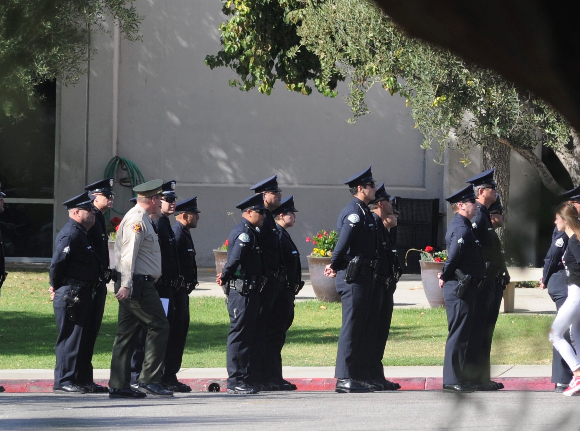 Officers from law enforcement agencies across the region line up outside Calvary Community Church in Westlake Village for the funeral services of Ventura County Sheriff's Office Sgt. Ron Helus.