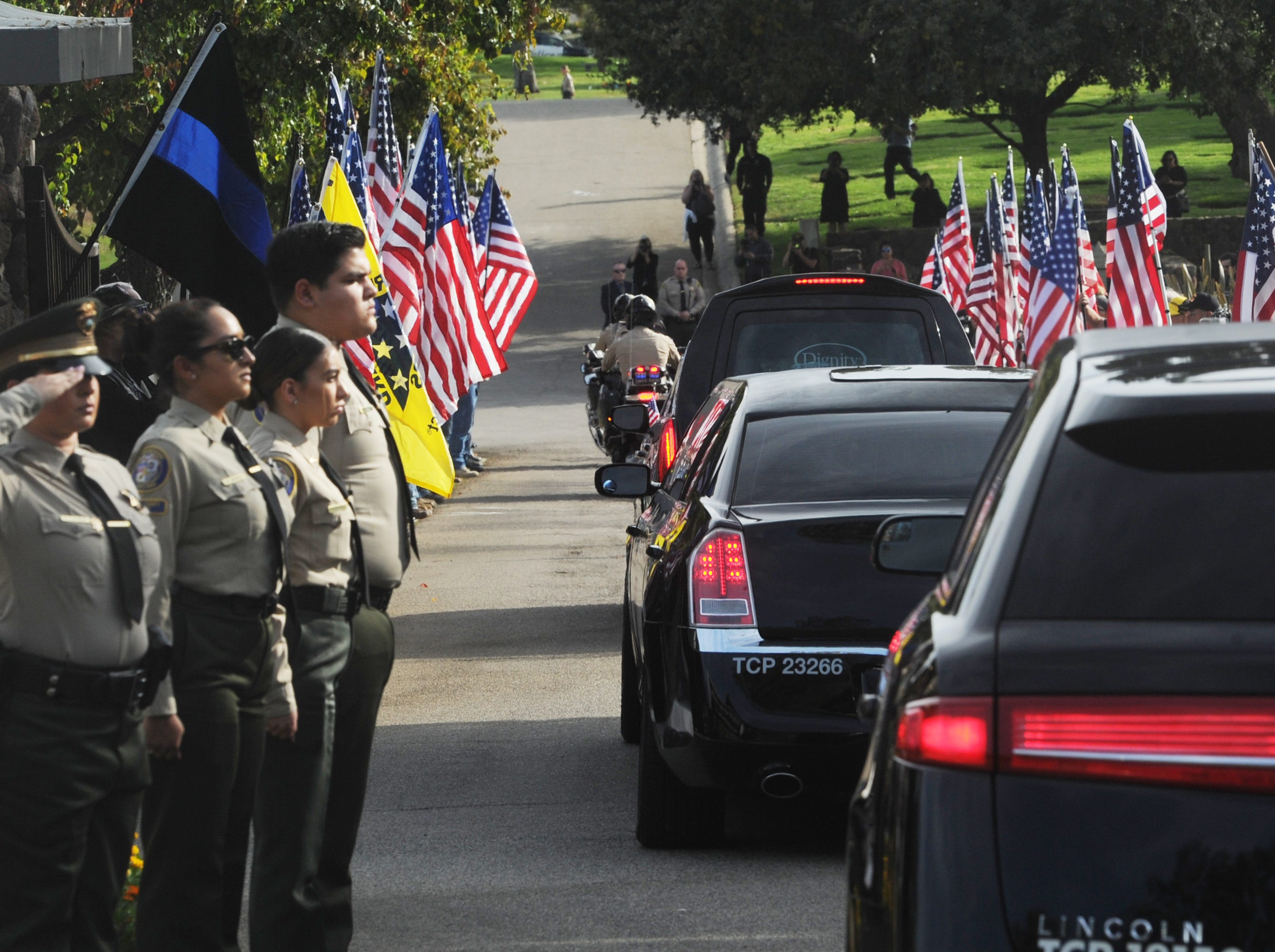 The funeral procession for Ventura County Sheriff's Office Sgt. Ron Helus arrives at Pierce Brothers Valley Oaks Memorial Park in Westlake Village on Thursday.