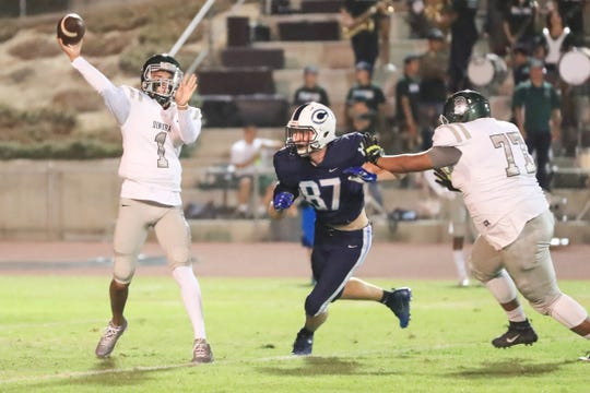 CVC's Grant Highstreet (87) puts pressure on Dinuba's QB Josh Magana (1) during a Central Sequoia League game with at CVC Football Stadium on Sept 28th, 2018.