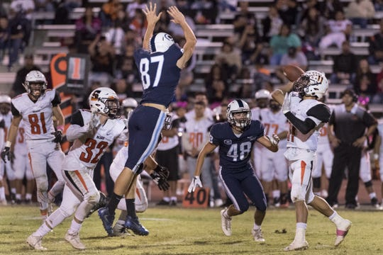 Central Valley Christian's Grant Highstreet, left, and Hayden Jones pressure Selma quarterback Jr. Ramirez to throw an interception in a Central Sequoia League high school football game on Friday, October 6, 2017.