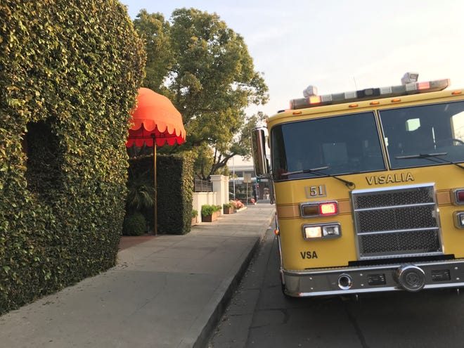 Visalia firefighters are at Vintage Press restaurant after reports of smoke coming from a restroom.