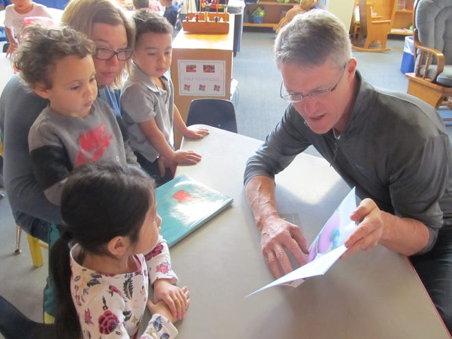 Volunteers from Domtar share a story with children at Head Start in Wausau.