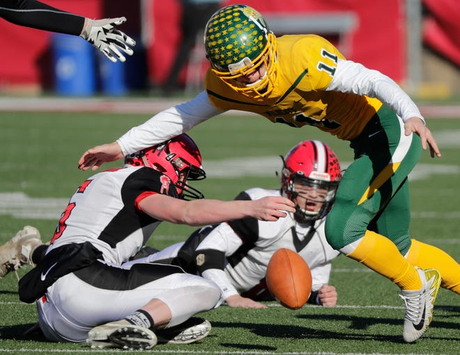 Edgar's Karson Butt (11) fumbles against Black Hawk in the WIAA Division 7 championship game Thursday at Camp Randall Stadium in Madison.