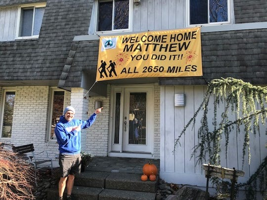Matthew Leichman, 27, is greeted at home in New City after his 2,650-mile hike of the Pacific Crest National Scenic Trail from May to November 2018.