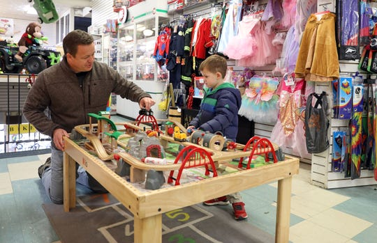 George Keller Mamaroneck plays with his son John, 3, at Miller's toy store in Mamaroneck Nov. 12, 2018.