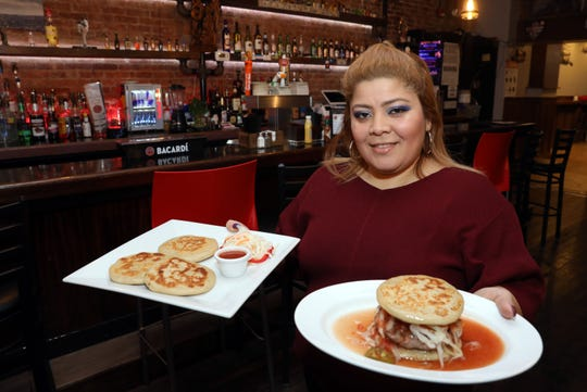 Owner Xiomara Jandres with the pupusa burger and pupusas at Kala'an Mul Bar & Grill in Yonkers Nov. 15, 2018. The family-owned business serves Mexican, Salvadoran and American food.